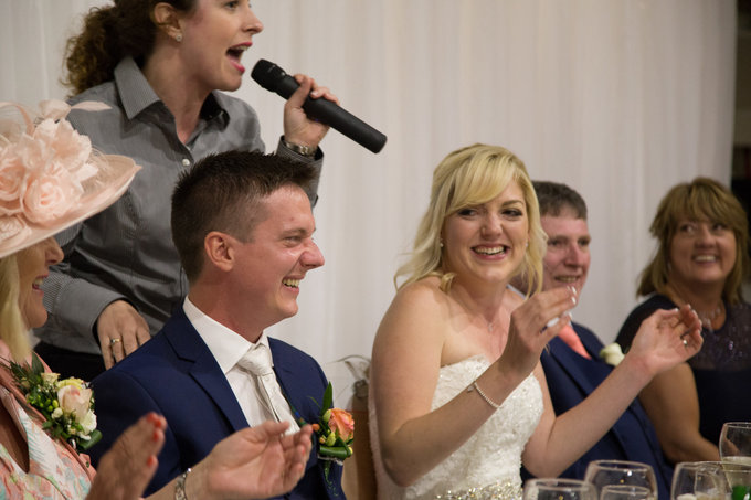 "The Bride and Groom enjoying a cheeky rendition of ""Master of the House"""